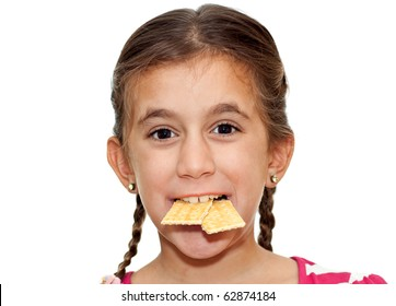 A glutton girl eating two crackers at the same time isolated on a white background