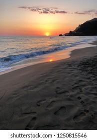 Glyfada beach sunset in Corfu, Greece