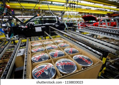 GMC logos on wheel center caps lie ready to be installed next to GM's Chevrolet Silverado and GMC Sierra pickup truck plant in Fort Wayne, Indiana, U.S., July 25, 2018.