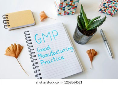 GMP Good Manufacturing Practice written in a notebook on white table