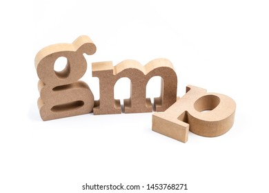 GMP wood alphabet isolated on white background, abbreviation of Good Manufacturing Practice
