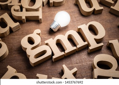 GMP wood alphabet in scattered letters with light bulb, abbreviation of Good Manufacturing Practice