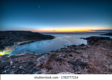 Gnejna Bay in Mgarr, Malta at dusk on a clear summer day