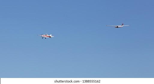 Gnesta, Sweden - September 20, 2015: An aircraft Piper PA-25-235 Pawnee towing a sailplane Pilatus B4-PC 11 against a clear blue sky.