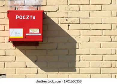 "Gniezno / Poland - 04.11.2020: Post box and its shadow. Polish post office ""Poczta Polska"""