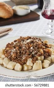 Gnocchi Bolognese. Food photography. Italian cuisine accompanied by bolognese sauce.