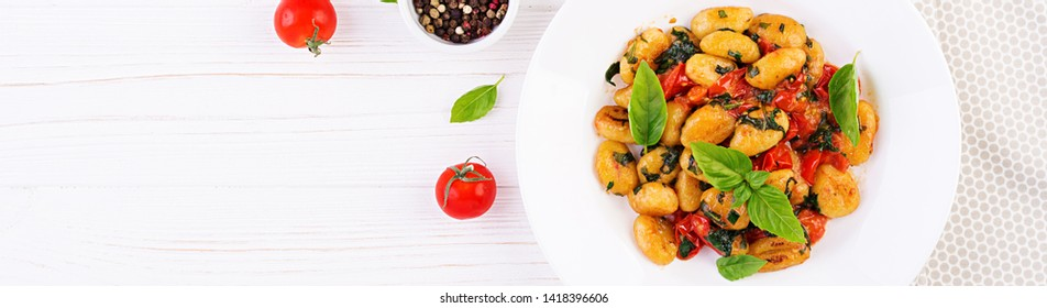 Gnocchi pasta in rustic style.  Italian cuisine. Vegetarian vegetable pasta. Cooking lunch. Gourmet dish. Banner. Top view