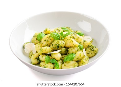 Gnocchi with pesto sauce isolated on white,