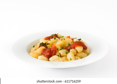 Gnocchi with tomato sauce isolated on white background