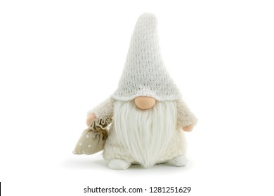 Gnome a beautiful christmas elf in thick warm coat with gift bag standing on white background