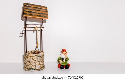 Gnome winks after repairing wishing well.