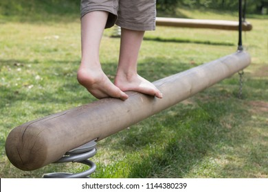 Go ahead. Success steps. Boy legs on a balance beam. Follow your dreams.