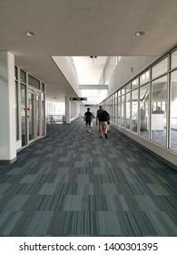 Walkway go to the Airplane door.Walkway decoration with translucent glass with carpet.