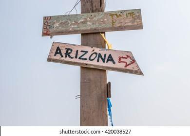 Go to Arizona on wood vintage arrow