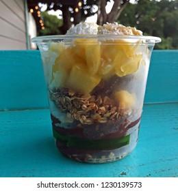 To go breakfast bowl: acai, greek yogurt, bananas, pineapple, coconut and granola, Hawaii