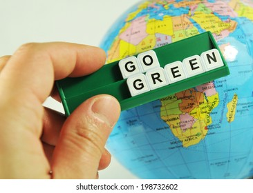 Go green concept with key words and Earth globe in the background