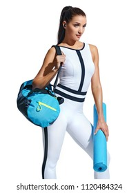 Go to gym! Attractive latin woman in fashionable sportswear with sports bag on white background. Sports and healthy lifestyle