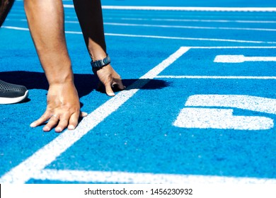 Go for it. Sports and Recreation comcept. Sport backgrounds. Sprinter on the start line of the track. Start of a track event. Get ready to run. Running, Sport, Athlete, Sprinting, Men