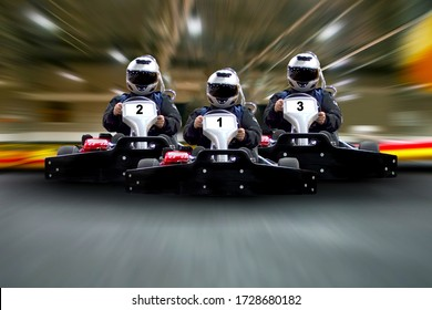 go kart indoor, cart racing fast, car where gokarting, we speed racing, racers banner. Three riders Go kart speed rive indoor race on the background of the track Copy space.