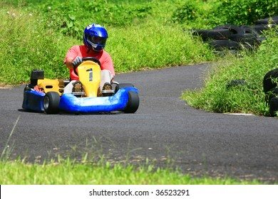 Go kart pilot turning left