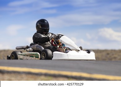 Go Kart Racer outdoors with blue sky.