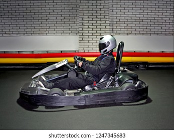 Go kart speed river indoor race opposition race. close up racer