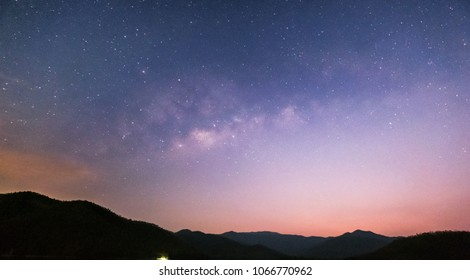 Go out on high mountains at night waiting for the stars and the Milky Way to shine in the dark sky. - Shutterstock ID 1066770962