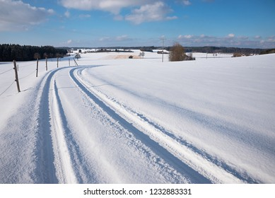 go out for a winter walk in the snowy rural landscape with curvy country lane. winter landscape bavaria