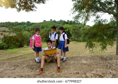Go to school, Little poor Asian students in school uniforms teaching sister and brother ,little students in traditional school dress at countryside,thailand.