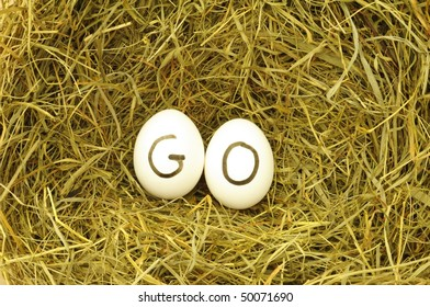 go or start concept with eggs on hey
