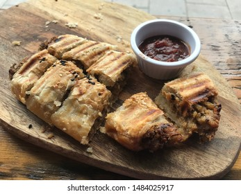 Go Vegan delicacy called Vegan sausage roll. Fantastic mamma for me for the most demanding. It is served with tomato vegetable sauce. Modern dietary trend with regard to health and nature.