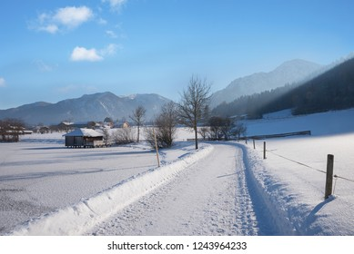 go for a walk along the frosty lakeside of lake schliersee in idyllic winter landscape upper bavaria