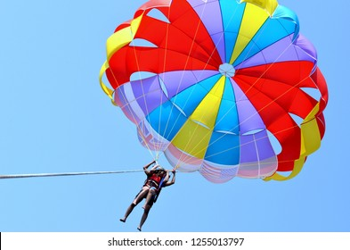 Goa, India, 2019. Low angle shot of a colorful parachute attached to a boat in the sea in Goa, India. Goa has the highest number of beautiful beaches in India.