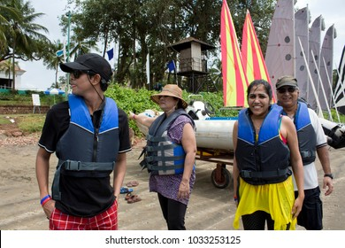 Goa, India - April 10, 2015: Group of people are getting ready to sail. Vacationers on beach with family on Goa.
