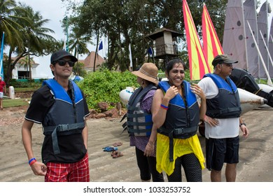 Goa, India - April 10, 2015: People getting ready to sail. Vacationers on beach with family on Goa.