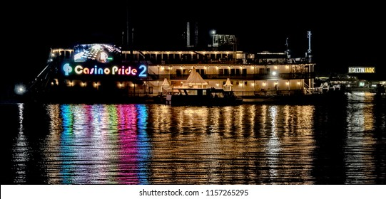 Goa, India - August 14, 2018 : Beautiful reflection of rainbow like spectrum of lighting on the Casino Pride 2 of Panjim, Goa. Major tourist attraction in all seasons, for legal gambling and betting.