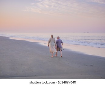 Goa, India - December 22, 2017 : Unidentified Senior man and woman couple taking a walk at beautiful sunny morning at South Goa beach