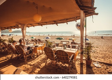 GOA, INDIA - FEB 5: Tourists relaxing in outdoor restaurant at chilling ocean beach on February 5, 2017. India's smallest state Goa has population near 1,500.000 people