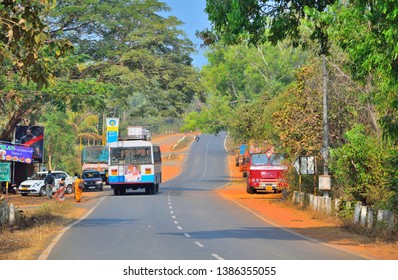 Goa, India - February 01, 2019: A public transport bus stopping on the road to pick and drop passengers.
