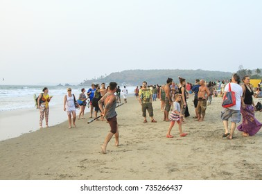 Goa, India - February 15, 2016: Unidentified people relaxing on the Arambol beach.