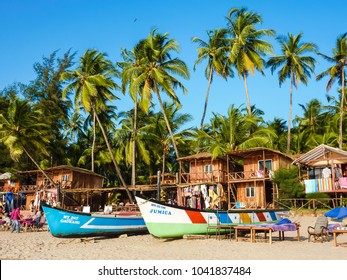 GOA, INDIA – February 26, 2011: Picturesque Goa beach. Sandy beach, fishing boats, palm trees, cafes and wooden bungalows, Palolem, South Goa. Beach is largely unspoiled,favorit tourist destination