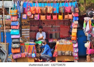 Goa, India - January 24, 2019: Street vendors selling colorful handbags in a shop.