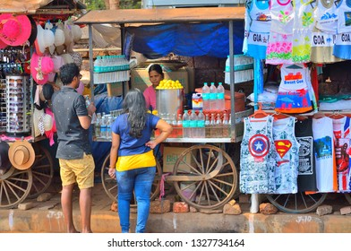 Goa, India - January 24, 2019: People buying water bottle from a roadside stall.
