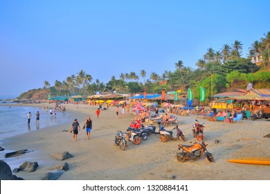 Goa, India - January 29, 2019: Tourists relaxing in the Ozran beach by the sea.