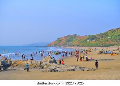 Goa, India - January 29, 2019: Tourists visiting the Vagator beach in Goa