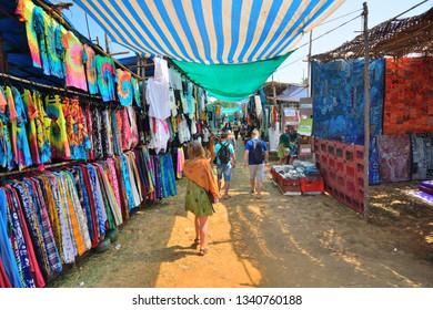Goa, India - January 30, 2019: Foreigners shopping at the Anjuna flea market.
