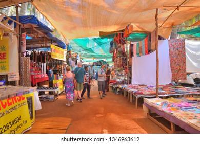 Goa, India - January 30, 2019: Tourists shopping at the Anjuna flea market in Goa.