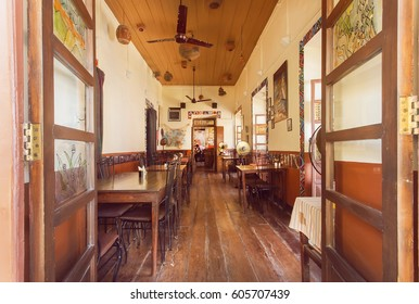 GOA, INDIA - MAR 1: Open window to cozy dining room of old style cafe in indian city on March 1, 2017. Near 5 million tourists visit Goa annually