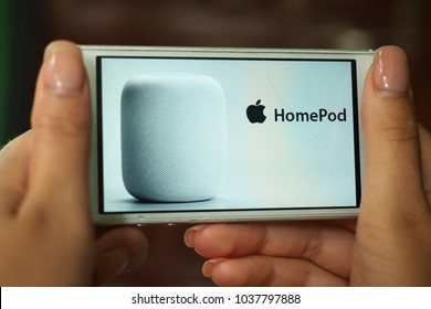 Goa, India - MARCH 3, 2018: Hands holding a smartphone with a logo of the Apple HomePod