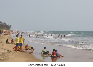 Goa / India - May 22 2018: A crowded beach in Goa on a hot and clear day.